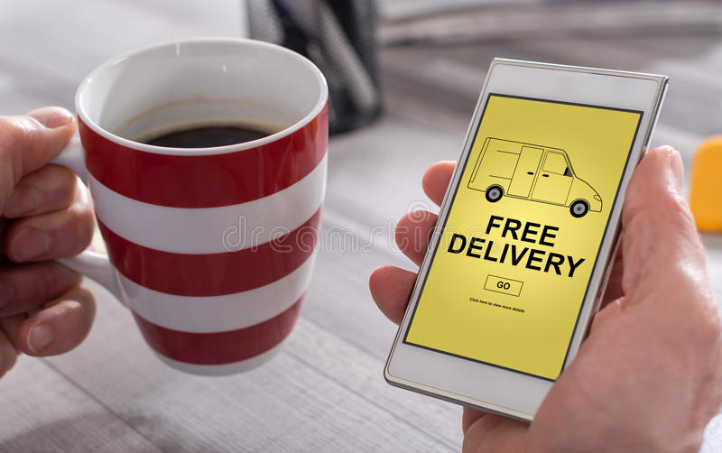 Free delivery concept on a smartphone royalty free stock images