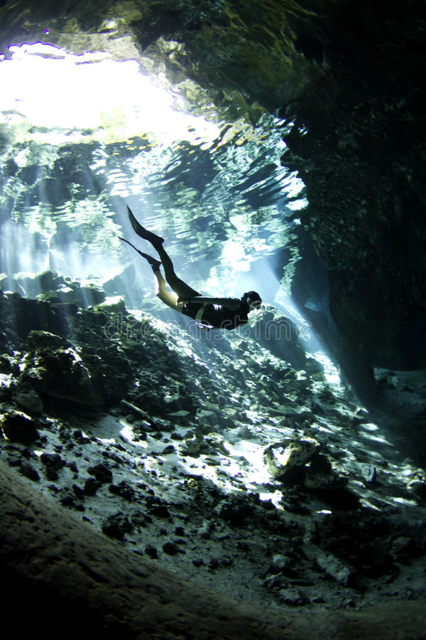 Free diver in cenote royalty free stock image