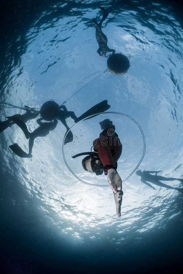 Free diver descending to the depht. Through air bubble ring stock photography
