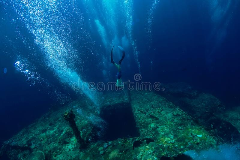 Free diver man dive at shipwreck, underwater sea stock photo