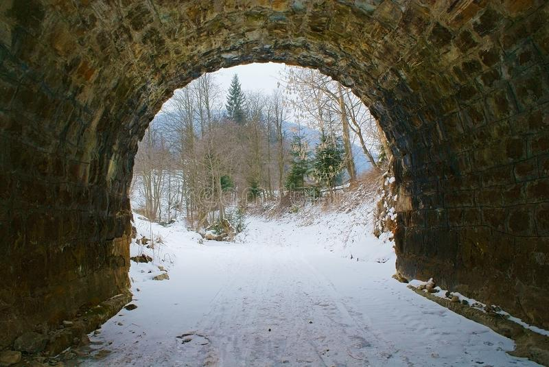 Exit from old stone tunnel to forest royalty free stock photos