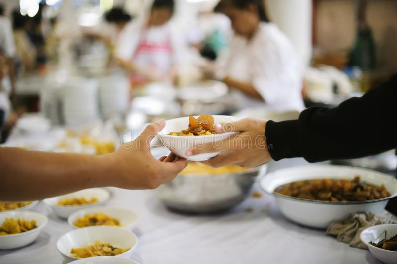 Free food for poor and homeless people donates food to food less people : Food concept of hope.  stock photography