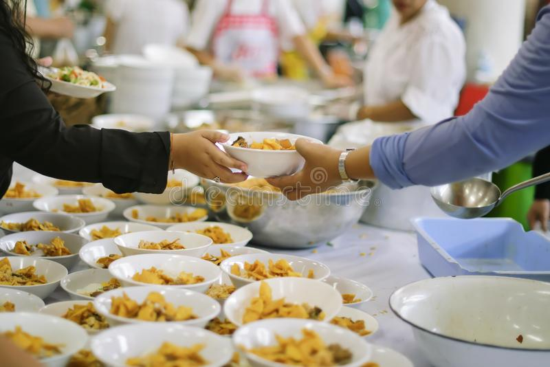 Free food for poor and homeless people donates food to food less people : Food concept of hope.  royalty free stock images