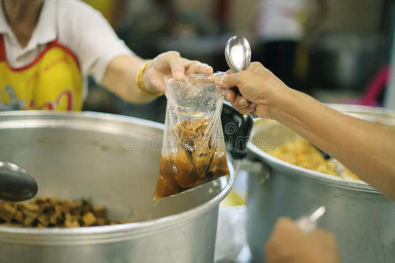 Free food for poor and homeless people donates food to food less people : Food concept of hope.  royalty free stock image