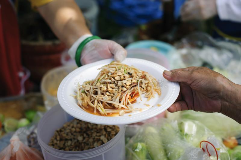 Free food for poor and homeless people donates food to food less people : The poor have been sharing food from the kinder society. To Relieve Hunger : Social royalty free stock photo