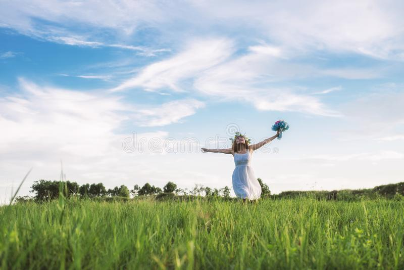 Free Happy Woman Enjoying Nature. Beauty woman playful,Freedom c. Oncept. Woman walking at meadows stock image