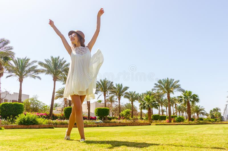 Free happy woman enjoying nature. Freedom concept. Beauty Girl over Sky and Sun in vacation. Enjoyment royalty free stock photos