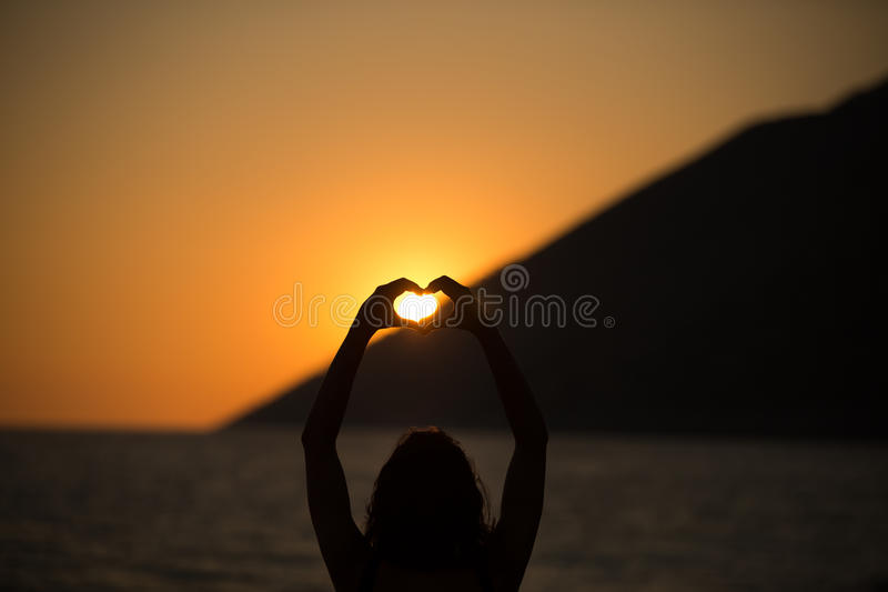 Free happy woman enjoying sunset..Embracing the golden sunshine glow of sunset,enjoying peace,serenity in nature.Vacation vitality royalty free stock photo