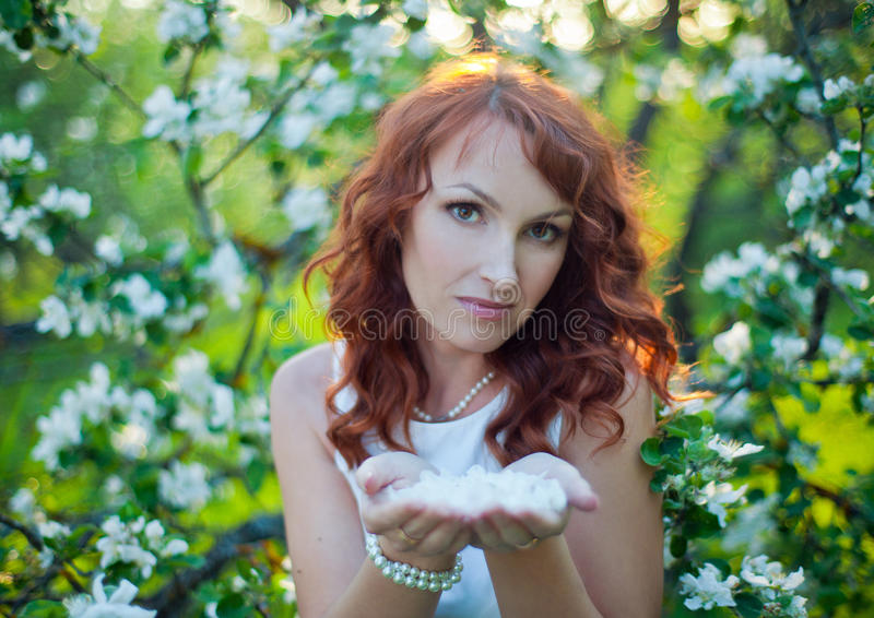 Free Happy Woman with Gorgeous Red Hair Enjoying Nature. Beauty Young Girl Outdoor in Spring Garden. Freedom concept stock image