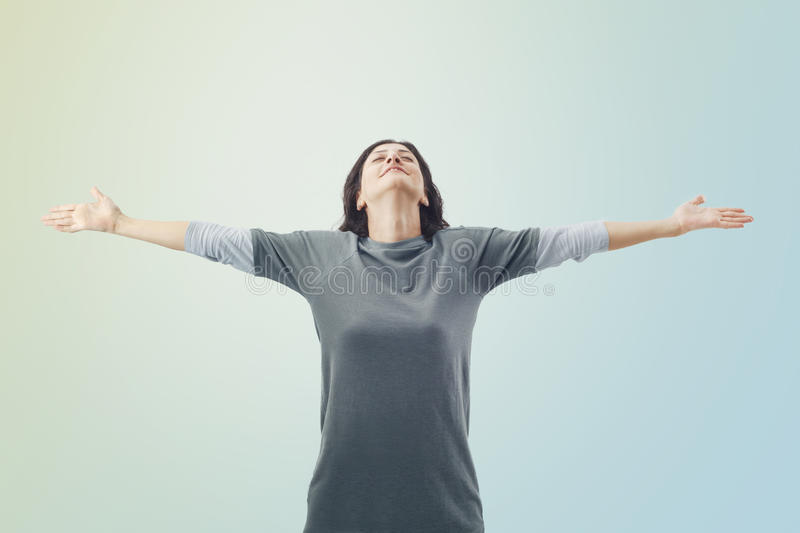 Free and happy woman on sky background stock image