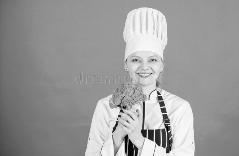 Free healthy vegetarian and vegan recipes. Healthy raw food. Dieting concept. Eat healthy. Girl wear hat and apron hold. Vegetable. Healthy ration. Woman stock image