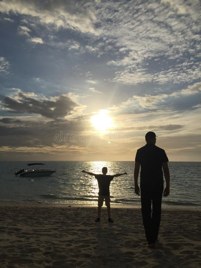 Free Hug. Love on the beach with a free hug stock photo