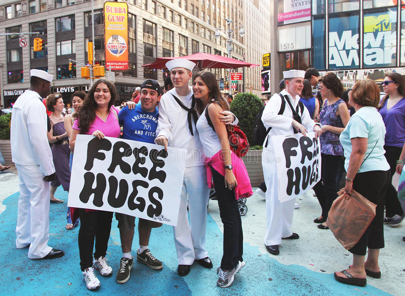 Free hugs. Sailors offer free hugs to strangers in times square during fleet week royalty free stock photo
