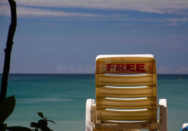 Free isolated beach chair on tropical island with panoramic view on horizon over turquoise water, Phuket, Thailand royalty free stock photos