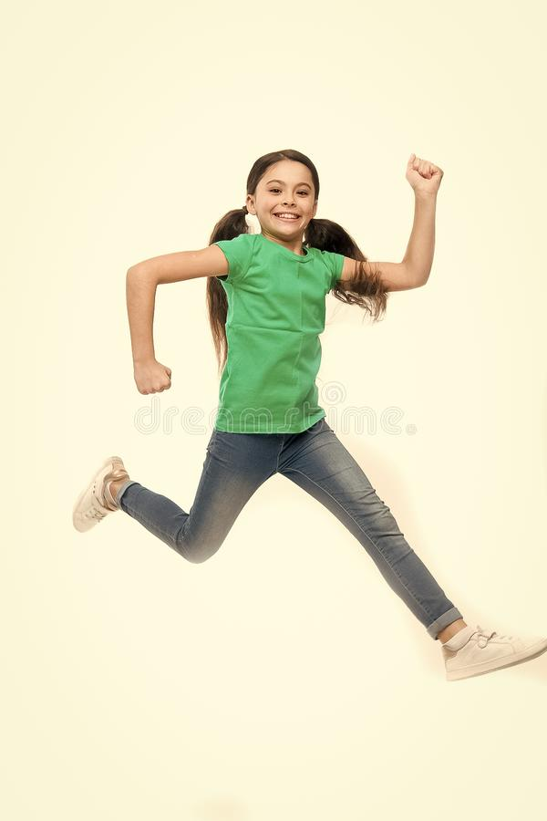 Free jumping. Adorable little girl with long brunette hair. Small child wearing casual fashion style. Small fashion. Model with beauty look. Little fashionista stock photos