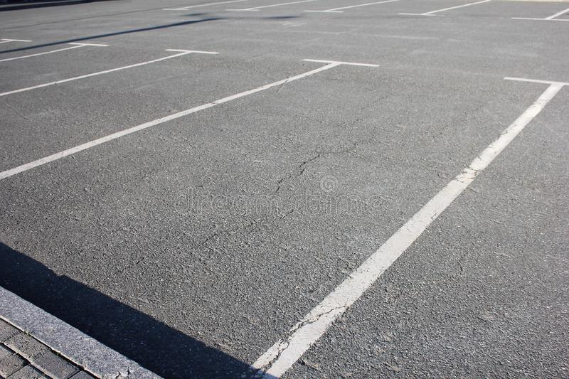 Free Parking spaces. Empty Parking lot. Paid and free Parking stock photo