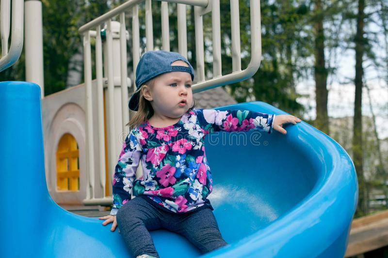 Free play in the playground for baby. Concept summer or spring activity for child development. stock photography