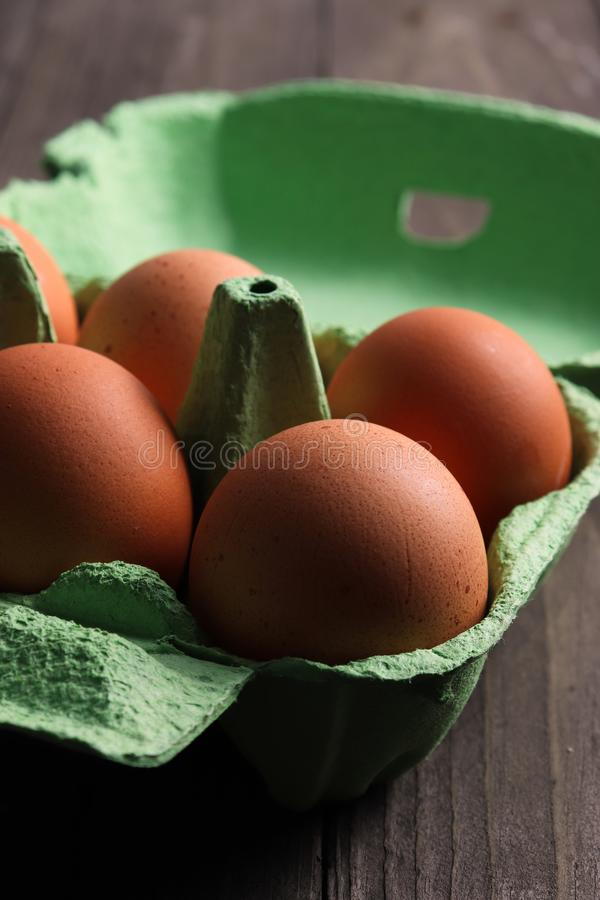 Free-range organic eggs in recycled paper box royalty free stock image