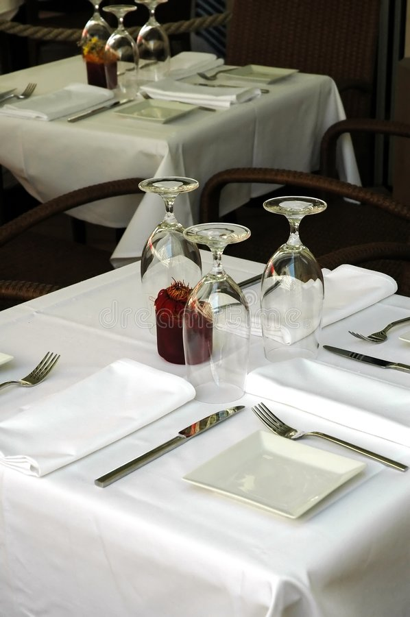 Free restaurant table on the street prepared for lunch royalty free stock photos