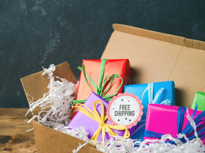 Free shipping concept with gift boxes. Free shipping concept with cardboard box and gift boxes royalty free stock photo