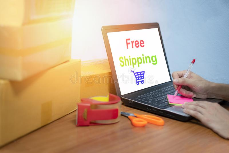 Free shipping laptop selling things online ecommerce delivery shopping online and order concept box parcels packing stock photos