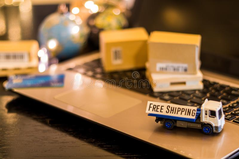 Free Shipping - still life logistics business concept with laptop, phone, mini shipping cartons. Logistics Supply Chain Challenges - still life logistics royalty free stock photos