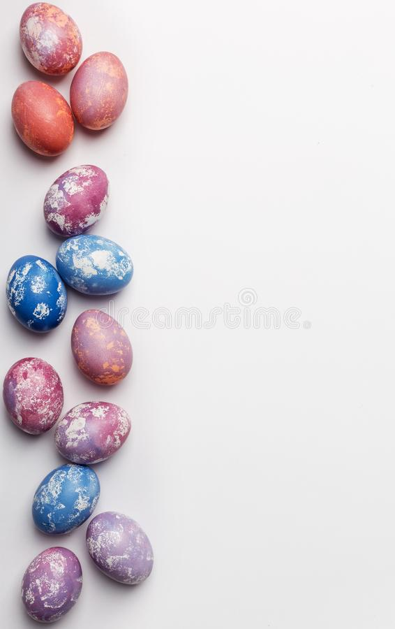 Free space background colorful easter eggs with copy space for text, isolated on white background royalty free stock images