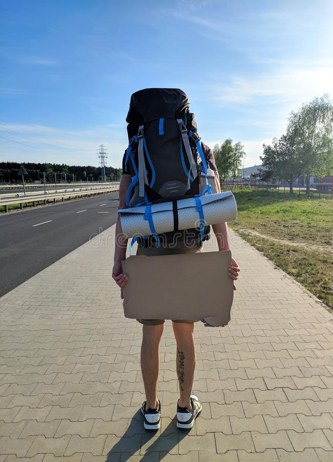 Free Space for Text on Traveler Board. Man in Poland. hitchhiking in Europe royalty free stock photo