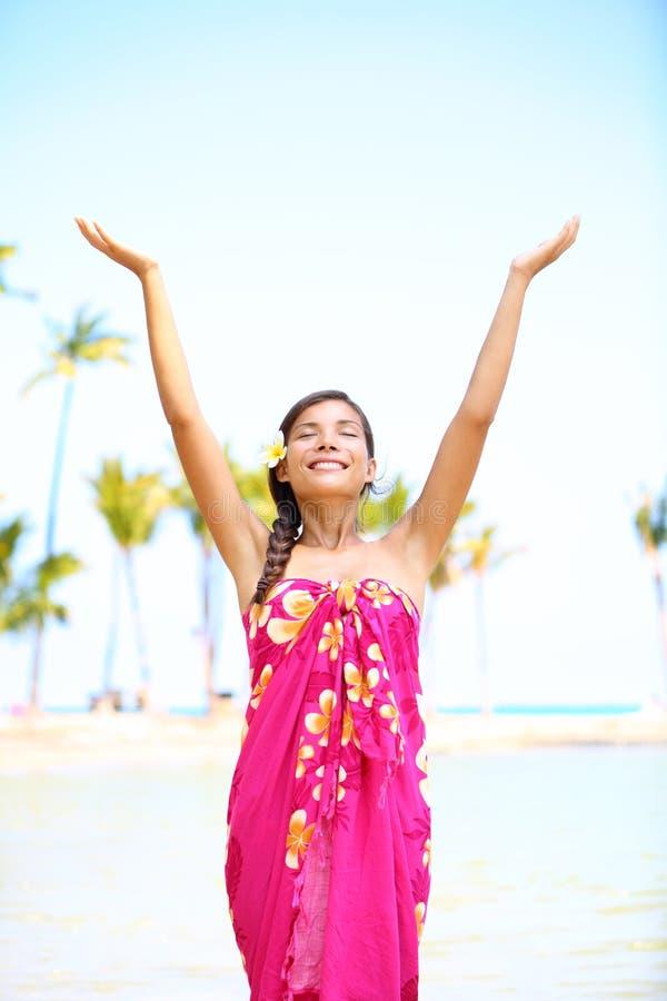 Free spiritual woman on hawaii on beach. Free spiritual girl on hawaii on beach in meditation freedom pose enjoying Hawaiian beach smiling serene and happy royalty free stock images