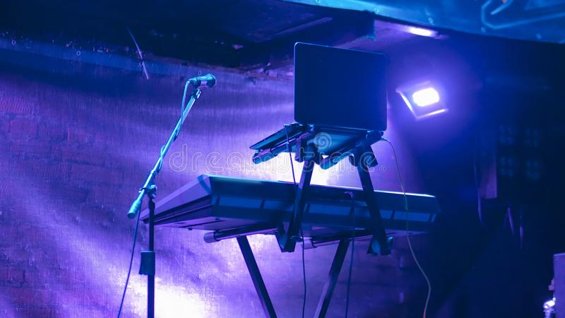 Free stage before concert. Lighting devices, microphone, notebook and synthesizer stock image