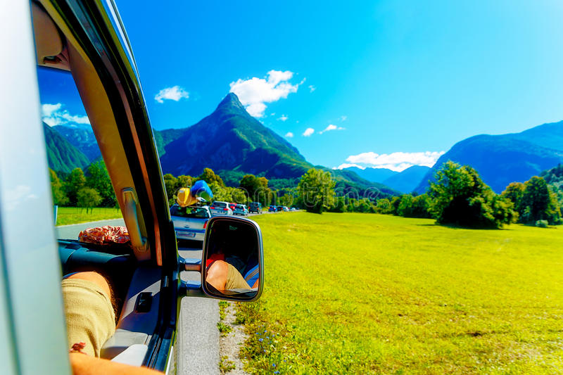Free summer car travelling road trip in beautiful mountain landscape stock photo