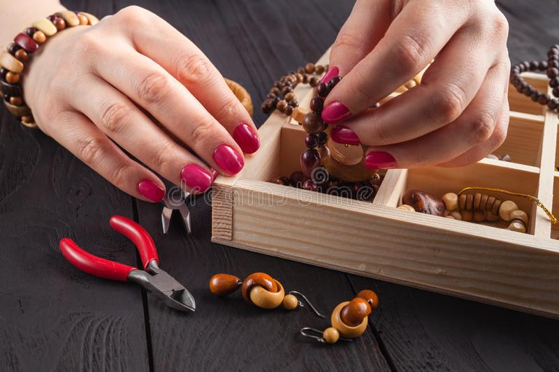 Free time evening making beads. Woman leisure home work, masterclass concept royalty free stock photography