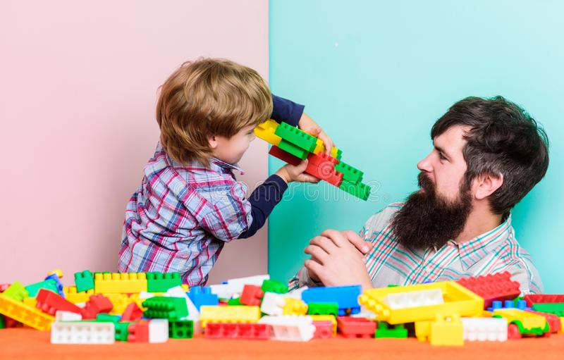 Free time. love. child development. father and son play game. Dream about fly. happy family leisure. small boy with dad. Playing together. building plane with royalty free stock photography