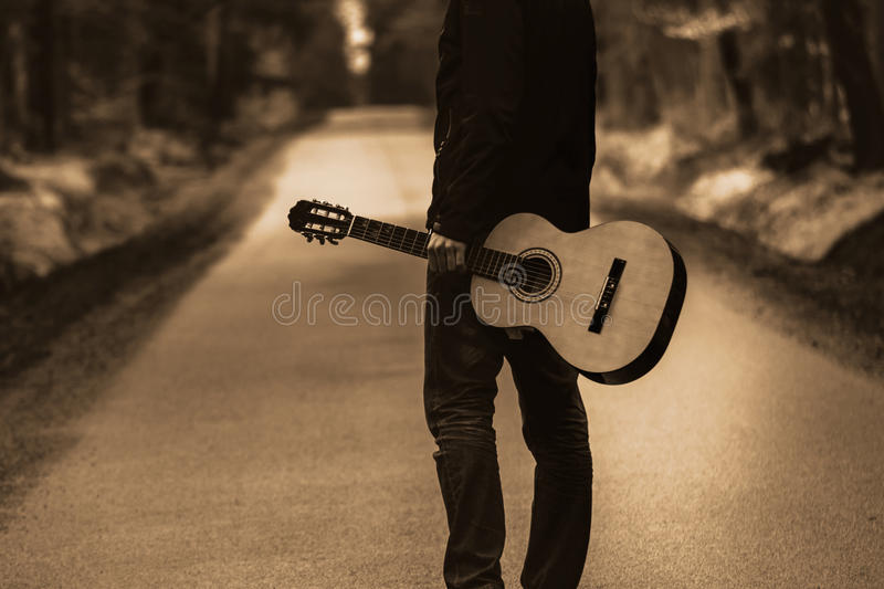 Free travel with country instrument, guitar in forest. royalty free stock photo