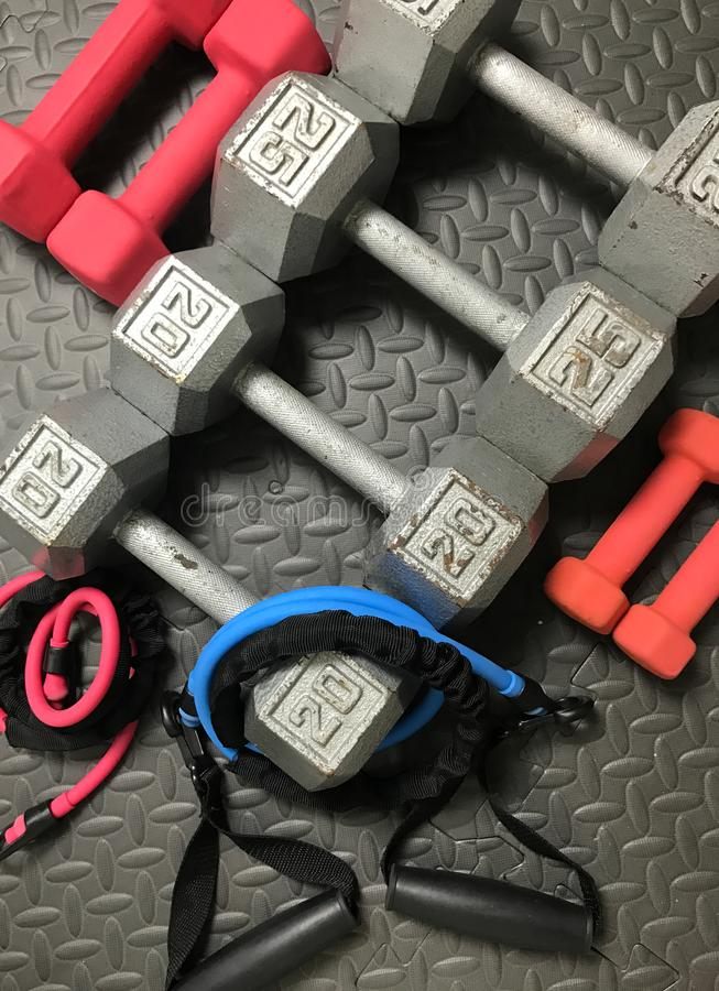 Free Weights and Resistance Bands. On a rubber workout mat stock photos