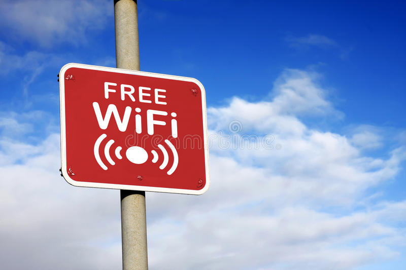 Free WiFi sign. Against a blue sky royalty free stock image