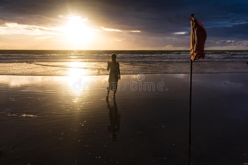 Free woman enjoying freedom feeling happy at beach at sunset. Beautiful serene relaxing woman in pure happiness and royalty free stock image
