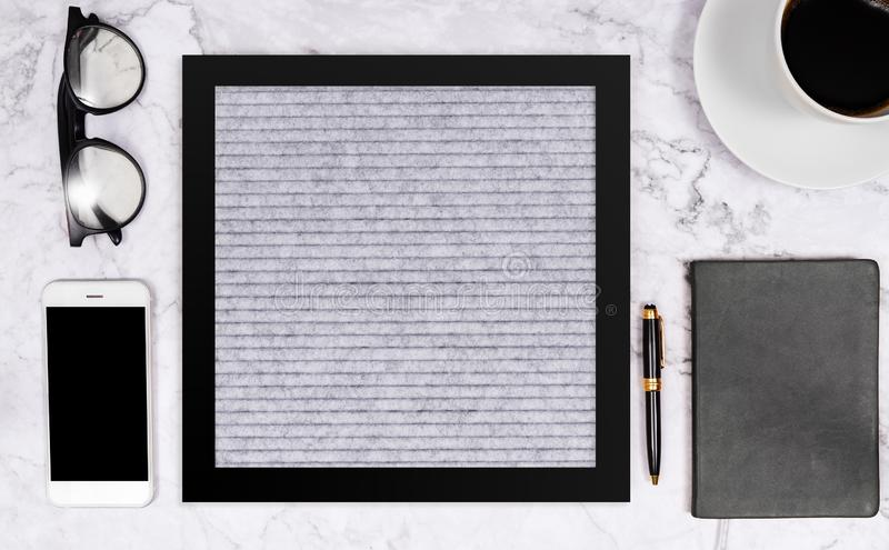 Free word on blank letter board in grey color on white marble desk background with coffee cup , notebook , pen , glasses royalty free stock images