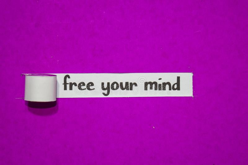 Free your mind, Inspiration, Motivation and business concept on purple torn paper royalty free stock photos