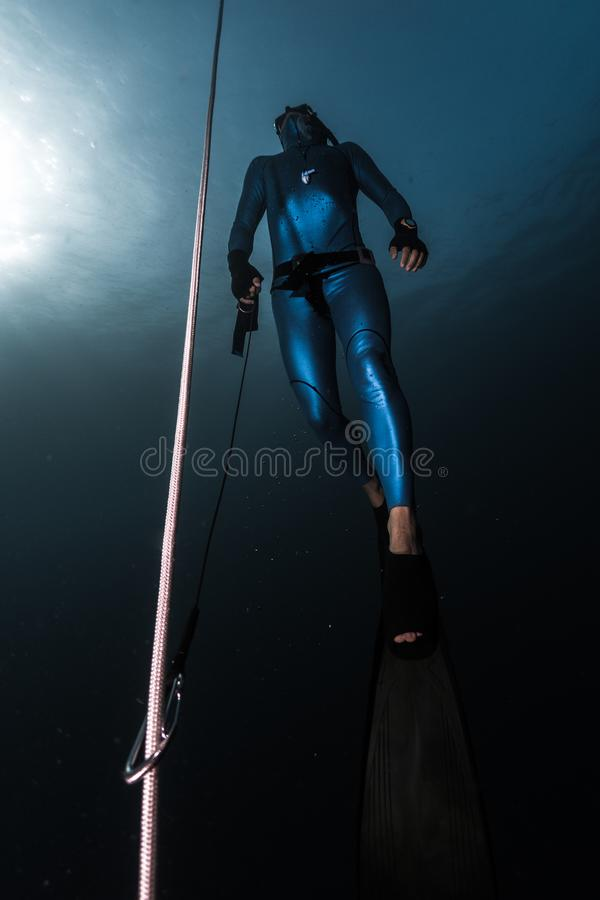 Freediver ascends from a depth stock photo