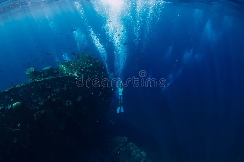 Freediver man dive underwater at shipwreck in Bali. stock photo