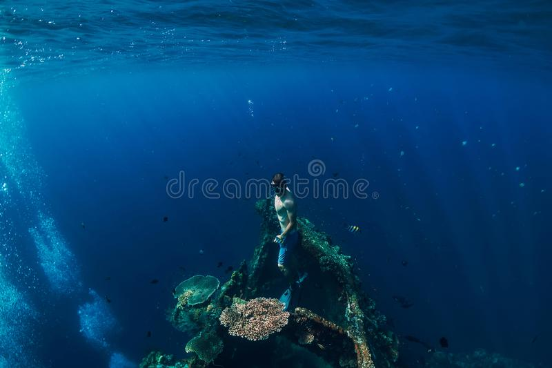 Freediver man dive underwater at shipwreck in Bali. Freediving stock images