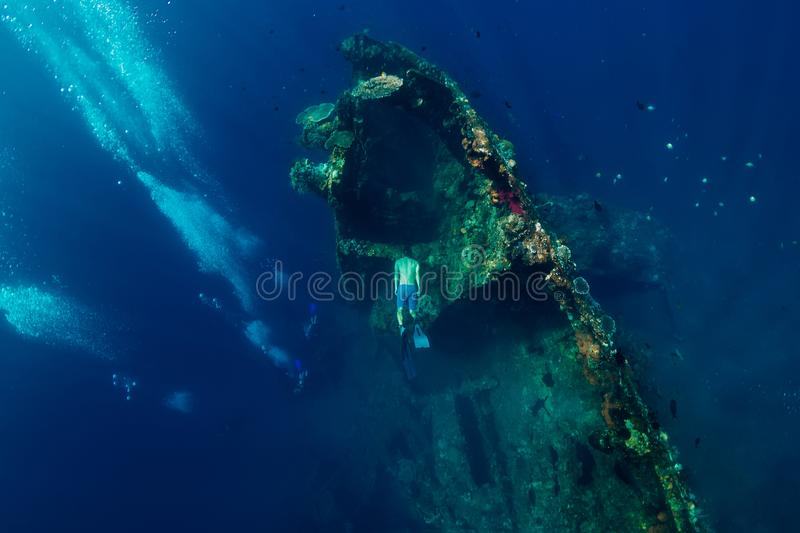 Freediver man dive underwater at shipwreck in Bali. Freediving stock photography