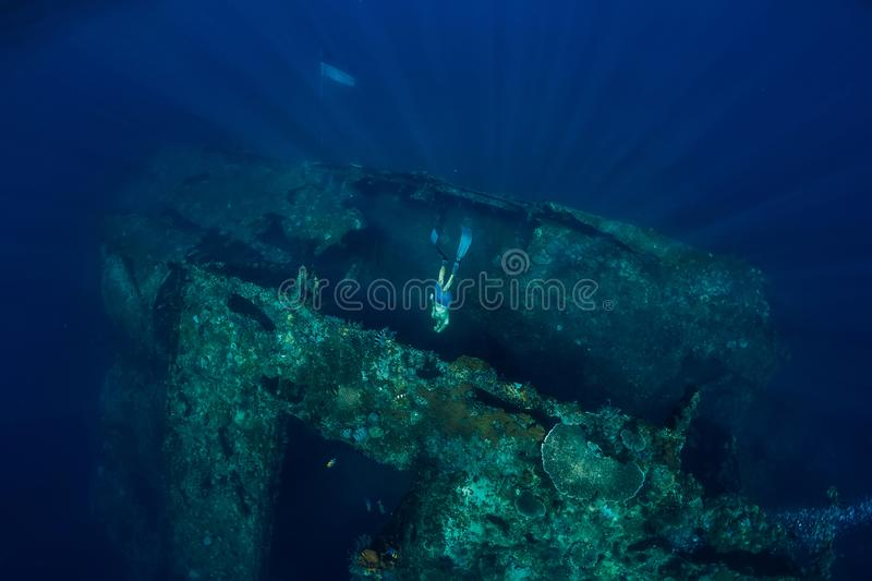 Freediver man dive underwater at shipwreck. Freediving in ocean royalty free stock photos