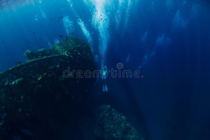 Freediver man dive underwater at shipwreck. Freediving in ocean stock photos