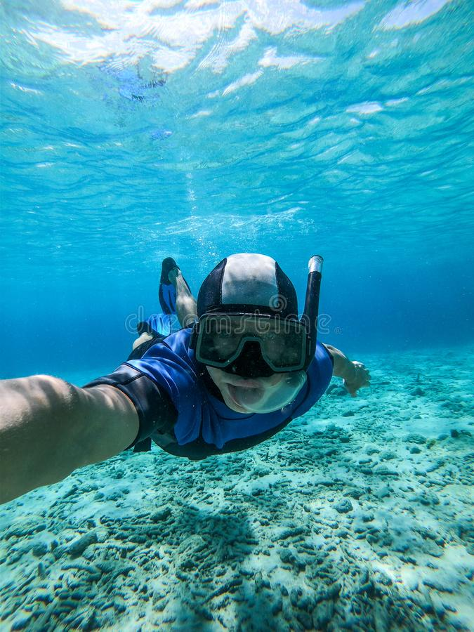 Freediver young man taking selfie portrait underwater royalty free stock image