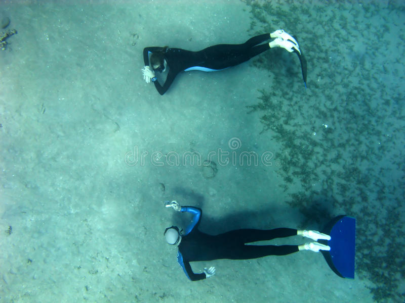 Freediving Photosession At The Bottom Of Red Sea Stock Images