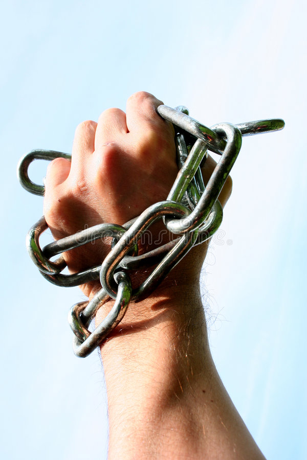 Freedom. Hand in chains stock photos