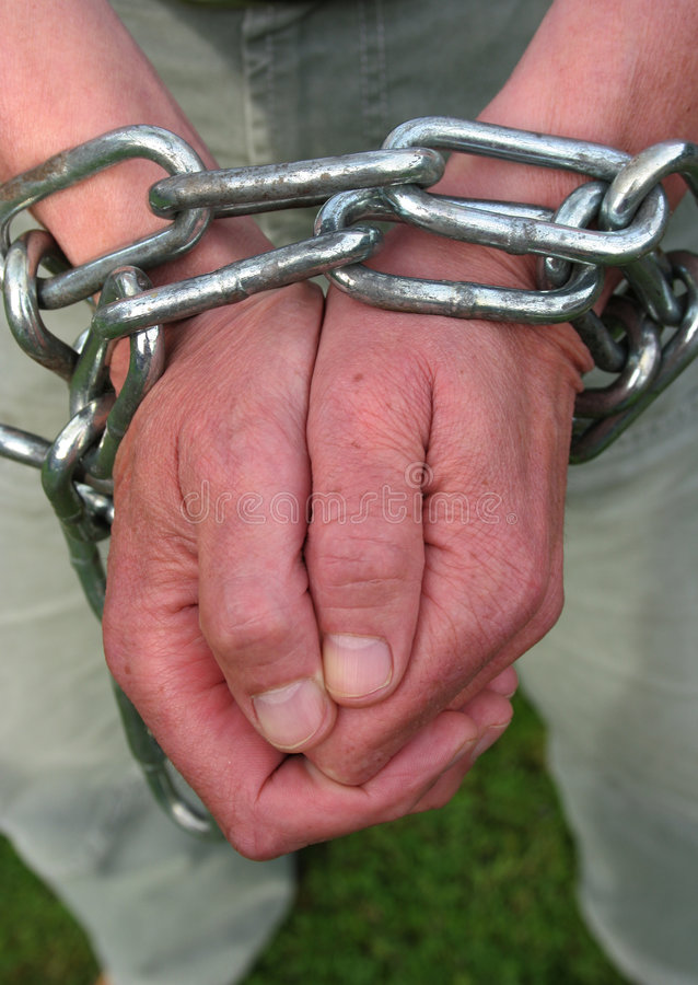 Freedom. Hand in chains royalty free stock image