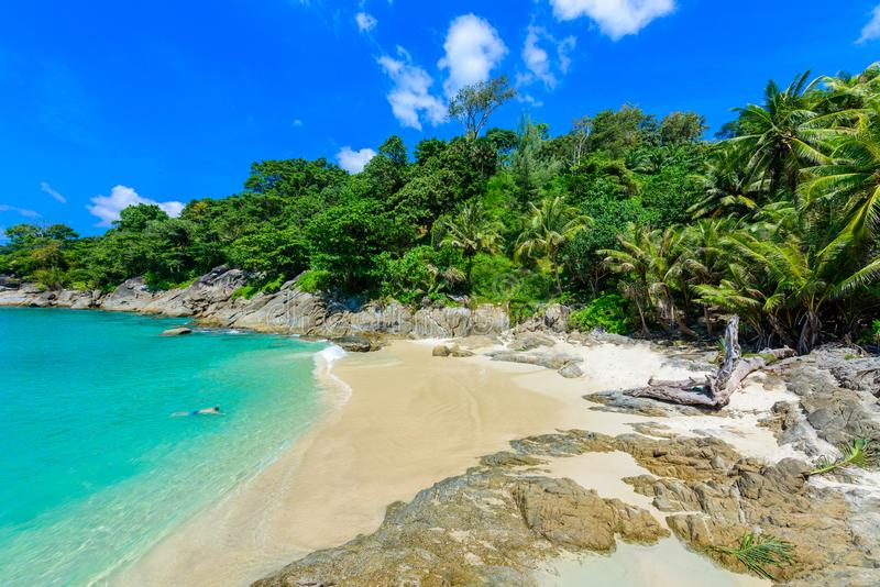 Freedom beach, Phuket, Thailand - Tropical island with white paradise sand beach and turquoise clear water and granite stones royalty free stock photos